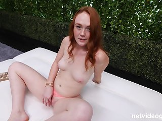 Redhead Brooklyn shows off her natural tits while she is fucking