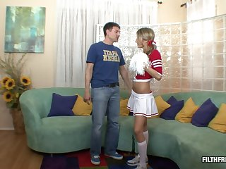 Cute cheerleader moans in pleasure while her juicy cunt is drilled