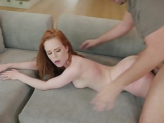 A redhead is getting fucked in her wet and sexy pussy on the sofa