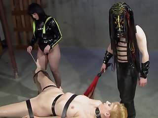 Leathered up goddess and her partner cover their slave in blow up expand on