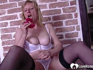 Glum blonde Susane smokes and masturbates passionately
