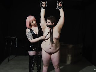 Chubby dyke's painful and pleasurable Lezdom session helter-skelter a curvy Domme